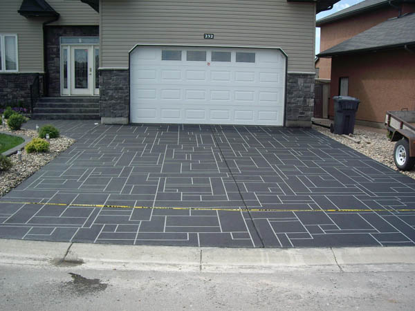 Driveway with concrete repair offers a unique look